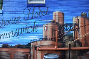Courthouse hotel beer garden wall mural exterior