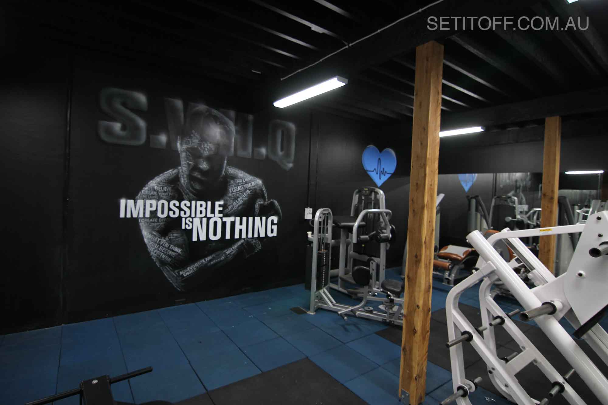 Motivational quote graffiti in a gym