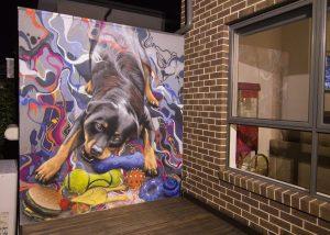 Graffiti mural of a dog