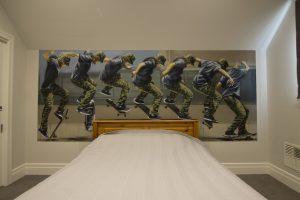 Skateboarding graffiti mural in kids bedroom