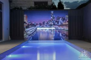 Poolside cityscape wall mural with incorporated fountain