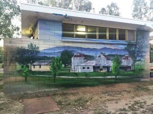 Old building exterior decorated with wall murals.
