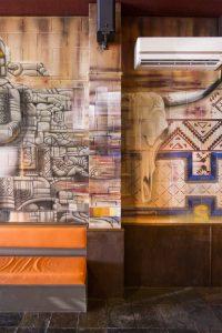 Pyramid graffiti spark up the interior of a Mexican restaurant.