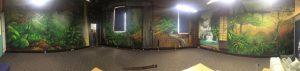 Three-wall urban rainforest spray paint wall mural interior.