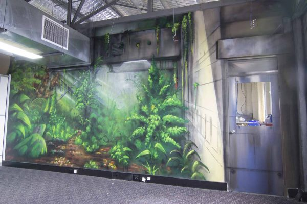 Three-wall urban rainforest spray paint wall mural interior.