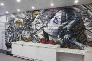 A tattoo-style wall mural in Kings of Ink tattoo studio.