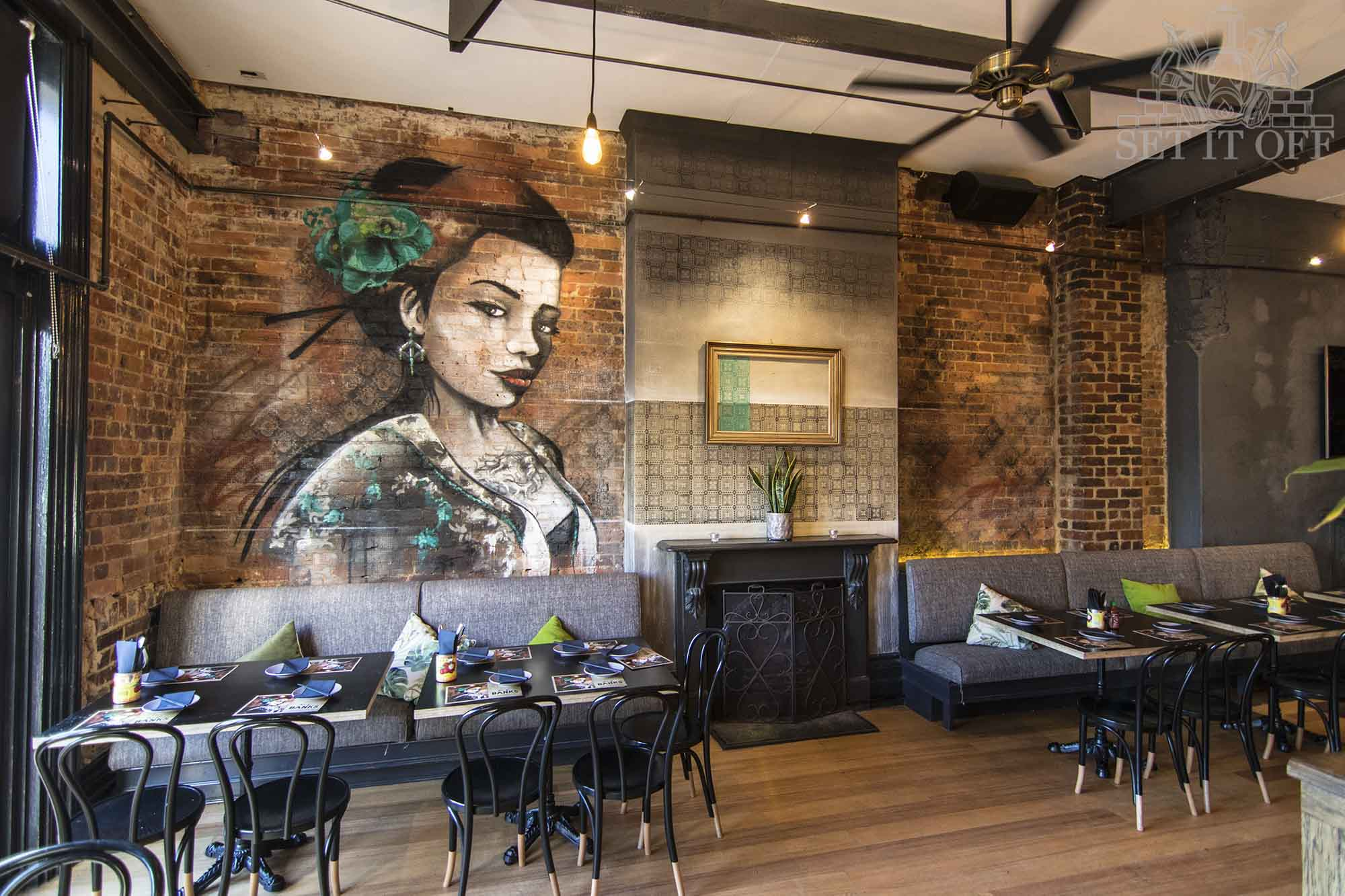 Interior Graffiti Mural Portrait with Fire Place