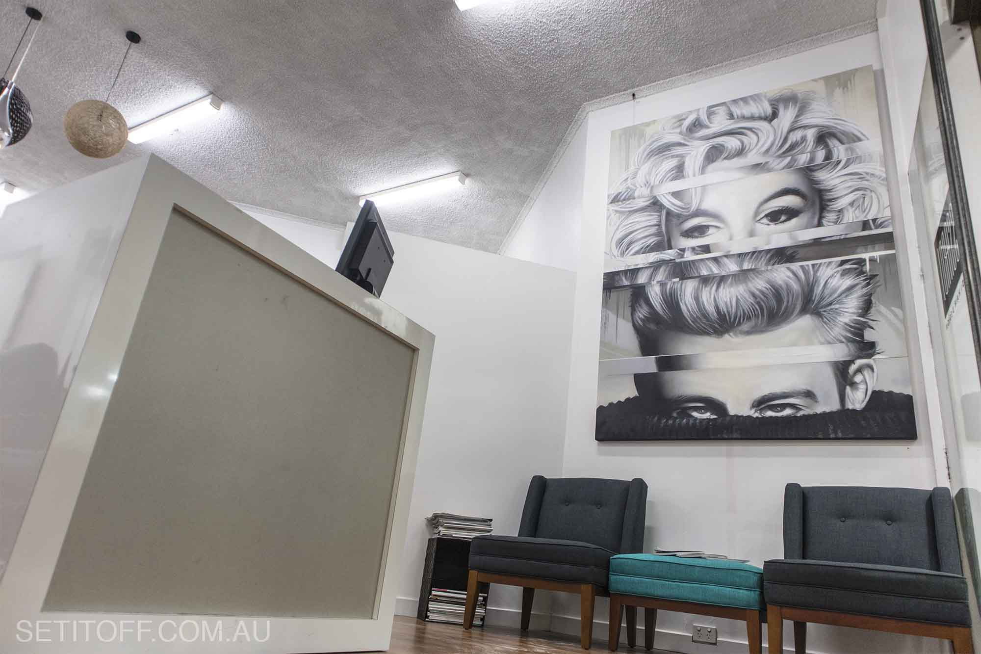 Portrait of Marilyn Monroe and James Dean on a canvas in hair salon