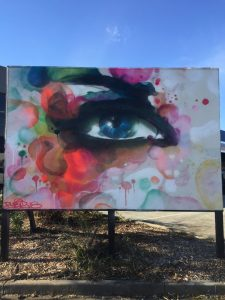 Graffiti of an eye in a abstract style on a billboard
