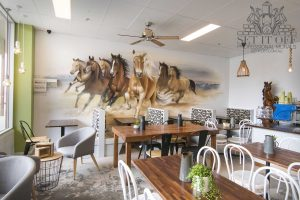 Horses graffiti mural in a cafe