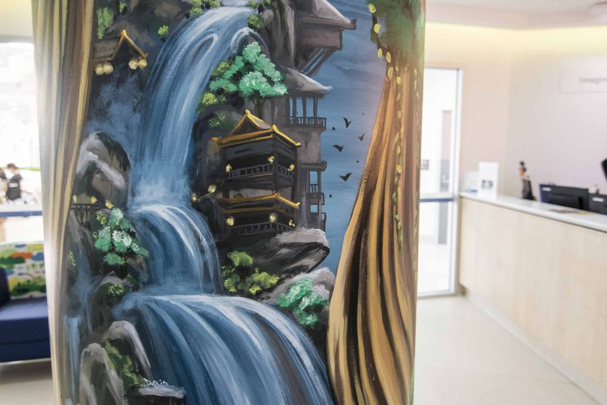 Enchanted tree mural on a pillar
