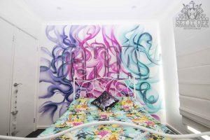 A custom name graffiti mural for kids bedroom.