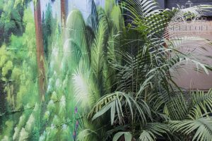 A tropical wall mural inside Forest cafe courtyard.