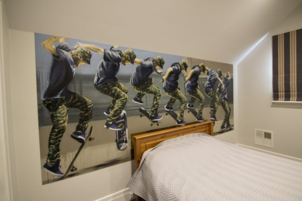 Skateboarding graffiti mural in kids bedroom
