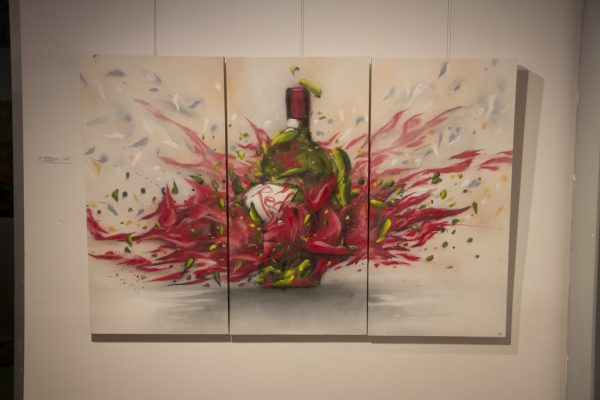 Wine bottle and a woman graffiti on a canvas