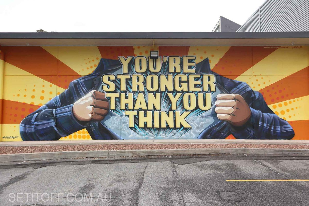 Motivational quote on a graffiti mural