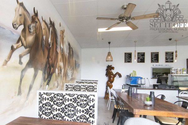 Horses graffiti mural in a cafe
