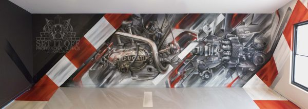 Graffiti mural of a motorcycle engine